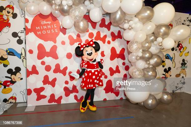 Minnie Mouse character attends Mickey The True Original Exhibition during National Polka Dot Day on 60 10th Avenue