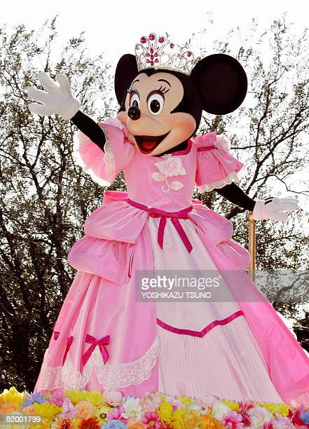 Minnie Mouse dressed up and wearing a tiara waves from a float during a parade of the 'Disney Princess Procession' at the Tokyo Disneyland 17 January...