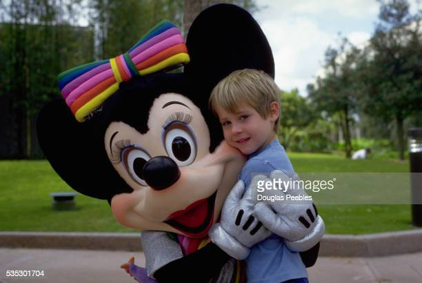 Minnie Mouse Hugging Boy at Disney World