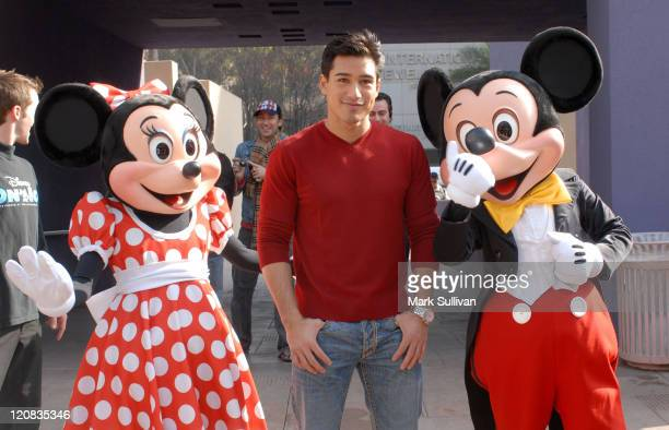 Minnie Mouse Mario Lopez and Mickey Mouse during Disney on Ice Celebrates 'Yes to Health and Fitness' at Pershing Square Ice Rink in Los Angeles...
