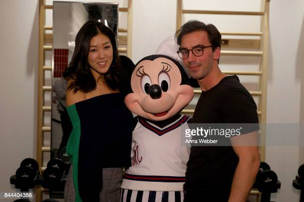 Minnie Mouse wearing custom Monse look poses backstage with Monse dcreative directors Laura Kim and Fernando Garcia at Monse SS18 NYFW show at The...