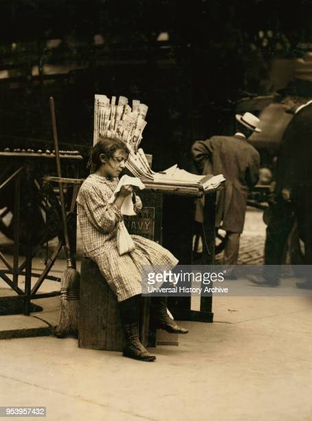 Minnie Paster 10 years Tending Newsstand Bowery and Bond Street New York City New York USA Lewis Hine for National Child Labor Committee July 1910