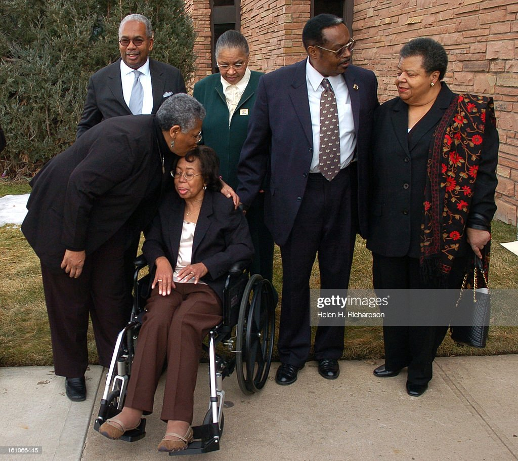 (HR) ABOVE: Minnijean Brown Trickey <cq> gives Thelma Mothershed Wair <cq> a kiss on the head while the group waits to have their photo taken. The others are Jefferson Thomas <cq>, Gloria Ray Karlmark <cq> Ernest Green <Cq> and Elizabeth Eckford <cq>. (Mi : News Photo