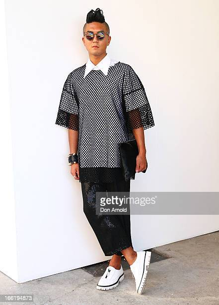 Mino Kim wears a shirt by Ralph Simmon mesh top by Zambesi and pants by Zambesi at MercedesBenz Fashion Week Australia Spring/Summer 2013/14 at...