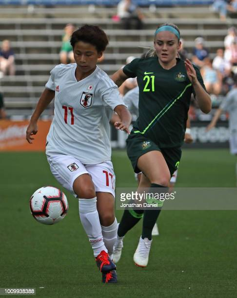 Mino Tanaka of Japan and Ellie Carpenter of Australia chase down the ball during the 2018 Tournament Of Nations at Toyota Park on August 2 2018 in...