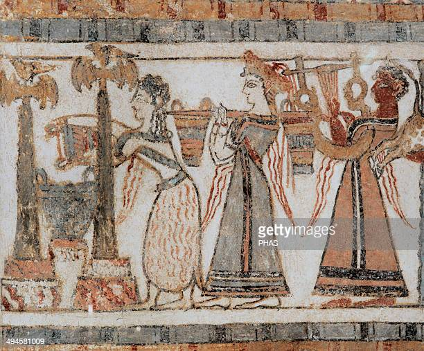 Minoan Art Crete The Hagia Triada Sarcophagus Painted with scenes from Cretan life Ritual Bull sacrifice Woman wearing a crown is carrying two...