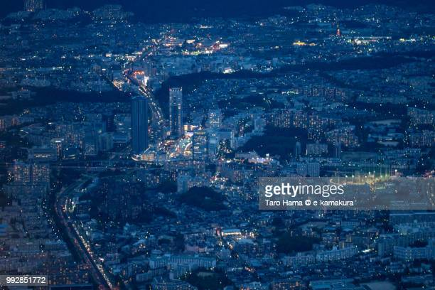 Minoh, Toyonaka and Suita cities in Osaka prefecture in Japan twilight time aerial view from airplane