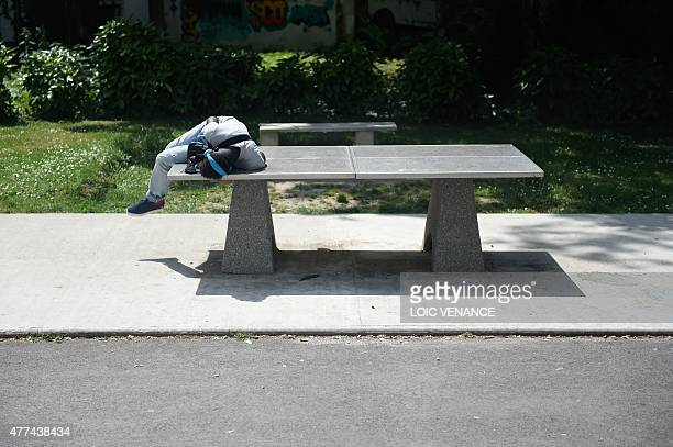 A minor child placed in a CEF lies on a tabletennis table in front of the center on June 16 2015 in SaintBricesousForet Created in 2002 those centers...