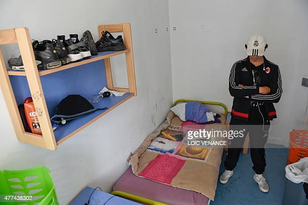 Minor child placed in a CEF poses in his bedroom, on June 16, 2015 at the center in Saint-Brice-sous-Foret. Created in 2002, those centers are...