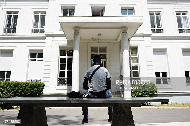 A minor child placed in a CEF sits on a tabletennis table in front of the center on June 16 2015 in SaintBricesousForet Created in 2002 those centers...