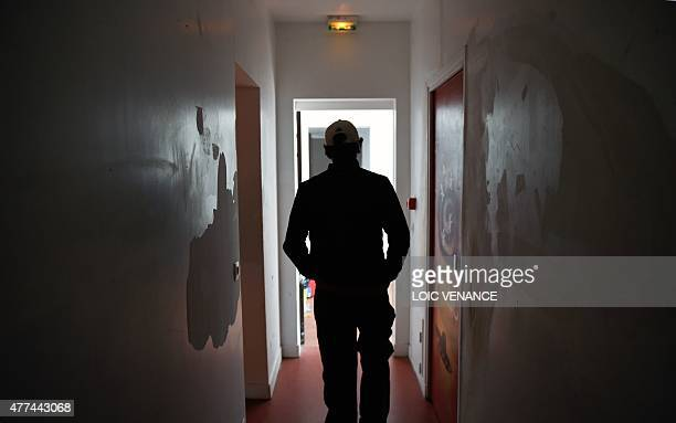 Minor child placed in a CEF walks in a corridor, on June 16, 2015 at the center in Saint-Brice-sous-Foret. Created in 2002, those centers are...