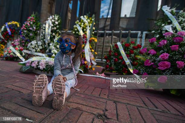 Minor child sits in front of the funeral wreaths with the names of demonstrators dead in police abuse of authority cases during the protests as...