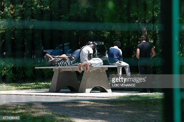 Minor children placed in a CEF sit on a tabletennis table in front of the center on June 16 2015 in SaintBricesousForet Created in 2002 those centers...