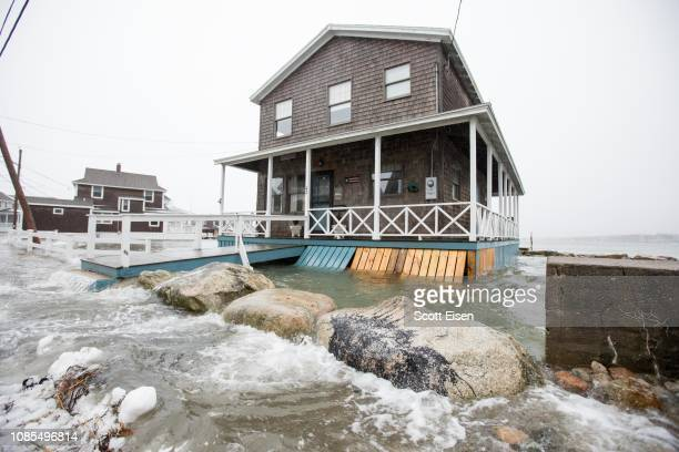 Minor flooding at high tide along Lighthouse Road during a winter storm that brought snow sleet and rain to the area on January 20 2019 in Scituate...
