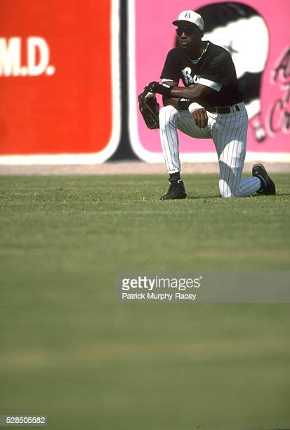Birmingham Barons Michael Jordan kneeling on one knee in outfield during game vs Greenville Braves at Rickwood Field Class AA Southern League...