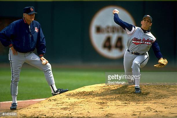 Minor League Baseball: Colorado Silver Bullets Gina Satriano in action, warming up with coach Joe Niekro before game, San Francisco, CA 5/14/1994
