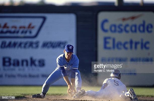 Medicine Hat Blue Jays Mike Coolbaugh in action attempting tag vs Great Falls Dodgers Great Falls MT 6/1/19906/30/1990 CREDIT Ronald C Modra