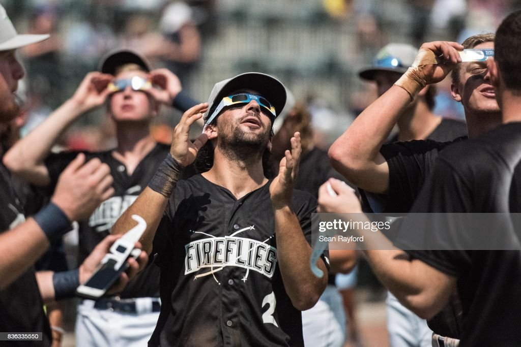 Minor league baseball player J.J. Franco watches the eclipse with teammates during a break in the game at Spirit Communications Park August 21, 2017 in Columbia, South Carolina. The astrological occurrence marked the first transcontinental total solar eclipse in 99 years.
