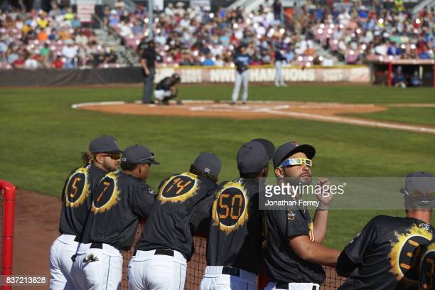 Rear view of Robinson Medrano and teammates wearing NASA eclipse glasses in dugout during game vs Hillsboro Hops at SalemKeizer Volcanoes at...