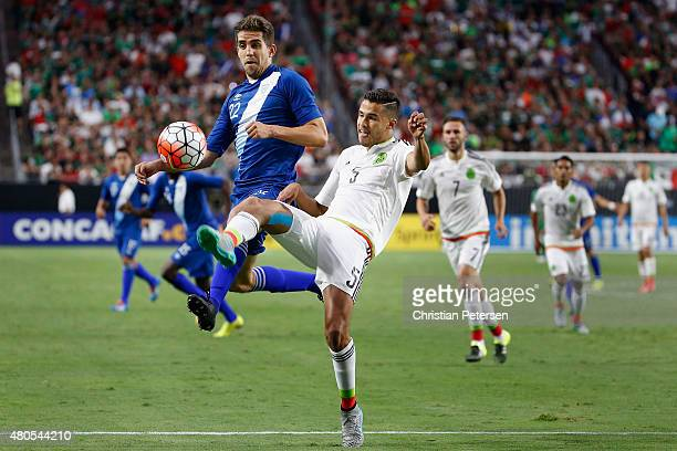 Minor Lopez of Guatemala attempts to control the ball against Diego Reyes of Mexico during the first half of the 2015 CONCACAF Gold Cup group C match...