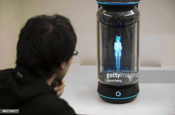 Minori Takechi chief executive officer of Vinclu Inc interacts with Hikari Azuma the first character for the Gatebox virtual home robot during a...