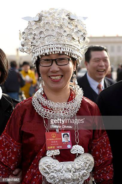 A minority delegate attends to the opening session of the China's National People's Congress on March 5 2016 in Beijing China Assembly spokesman Fu...