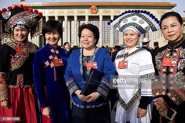 Minority delegates stand in front of the Great Hall of the People during the opening session of the China's National People's Congress on March 5...