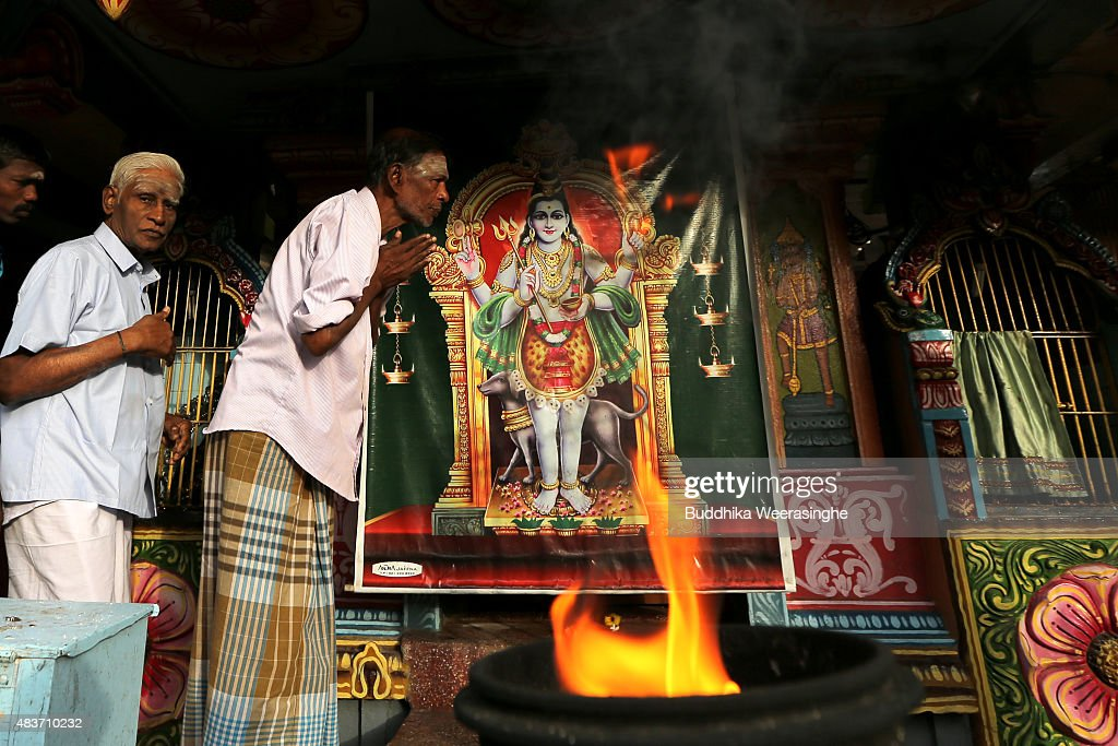 Minority ethnic Tamil men pray in the Hindu temple on August 12,2015 in Jaffna, Sri Lanka. The UN's Human Rights Council investigation into alleged war crimes committed by both the Sri Lankan Government and the Liberation Tigers of Tamil Eelam (LTTE) during the Sri Lankan Civil War is due to be released in September.