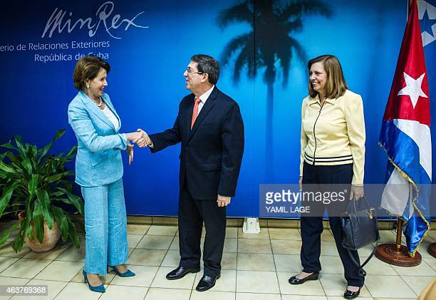 Minority Leader of the United States House of Representatives Nancy Pelosi shakes hands with Cuban Foreign Minister Bruno Rodriguez upon hers arrival...