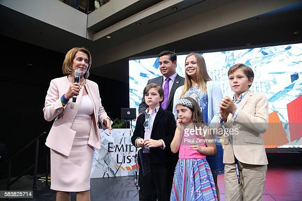 Minority Leader of the United States House of Representatives Nancy Pelosi speaks onstage with her grandchildren at EMILY's List Breaking Through...