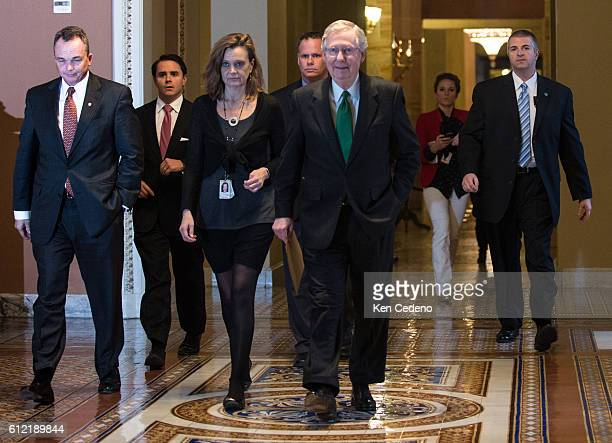 Minority Leader Senator Mitch McConnell walks to the Senate floor with his staff to consider a possible deal to prevent the 'fiscal cliff' on Capitol...