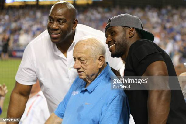 Minority Los Angeles Dodger owner Magic Johnson and Los Angeles Dodgers legend Tommy Lasorda pose for a photo during Game 1 of the 2017 World Series...