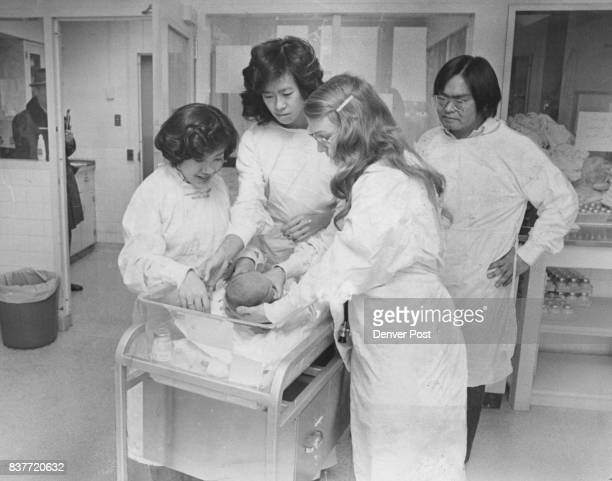 Minority Students Learn About Jaundice In TwoDayOld Baby From left Cheryl Yamaguchi and Doris Wong are briefed by Dr Marianne Neifert teacher Donald...