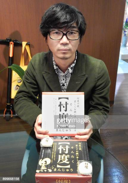 Minoru Inamoto president of Heso Production holds a box of 'Sontaku Manju' buns in Osaka western Japan on Nov 29 2017 The bun takes its name from a...