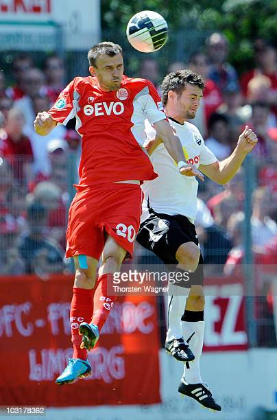 Minres Mesic of Offenbach battles for the ball with Jan Andre Sievers of Sandhausen during the Third League match between SV Sandhausen and Kickers...