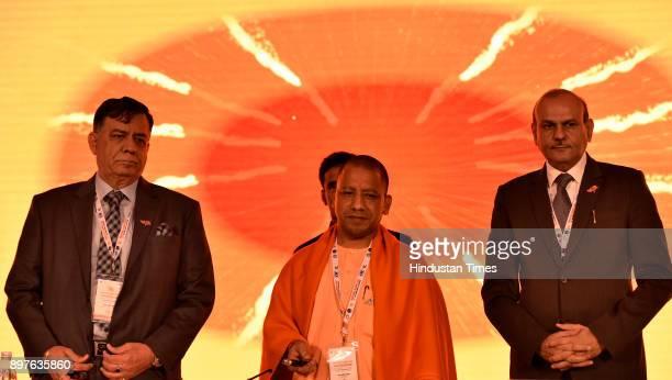 MUMBAI INDIA DECEMBER Minsiter of Industrial Development Satish Mahana UP CM Yogi Adityanath and Chief Secretary Rajive Kumar during the launch of...