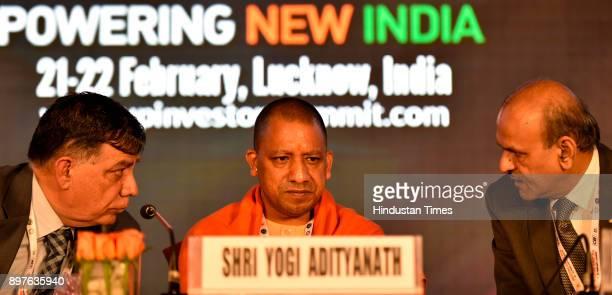Minsiter of Industrial Development Satish Mahana UP CM Yogi Adityanath and Chief Secretary Rajive Kumar during the launch of Logo and Mobile...