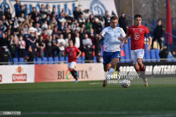 FC Minsk and FC DinamoMinsk team players vie for the ball during the Belarus Championship football match in Minsk on March 28 2020 Belarus continue...
