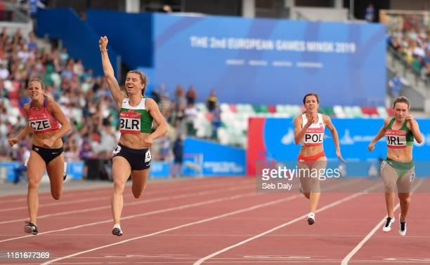 Minsk Belarus 23 June 2019 Krystsina Tsimanouskaya of Belarus second left celebrates as she crosses the line to win the Women's 100m during Dynamic...