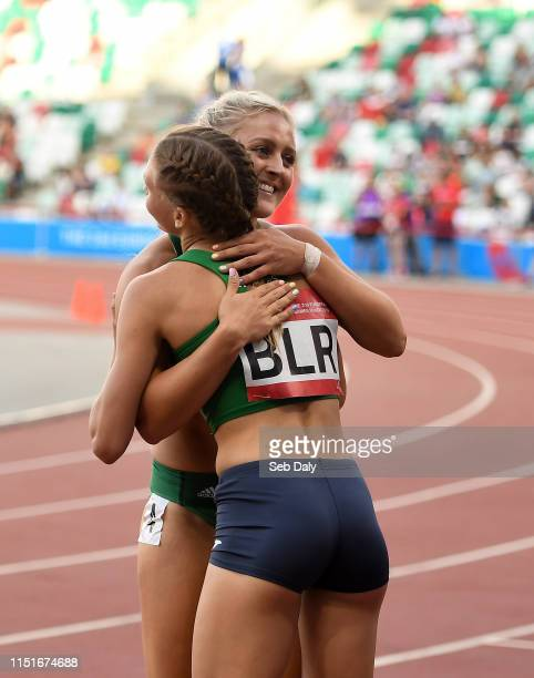 Minsk Belarus 23 June 2019 Sarah Lavin of Ireland congratulates Elvira Herman of Belarus after finishing second to her in the Women's 100m hurdles...