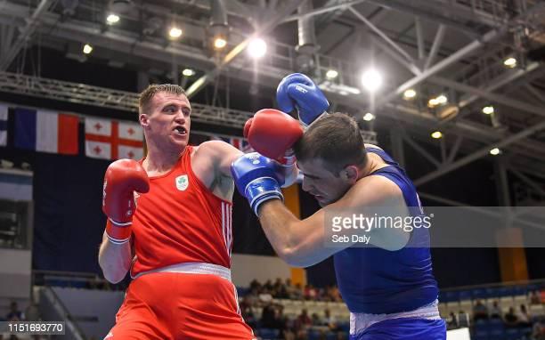 Minsk Belarus 24 June 2019 Dean Gardiner of Ireland left in action against Mikheil Bakhtidze of Georgia during their Men's Super Heavyweight bout at...