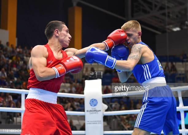 Minsk Belarus 24 June 2019 Kurt Walker of Ireland right in action against Zhirayr Sargsyan of Armenia during their Mens Bantamweight bout at Uruchie...