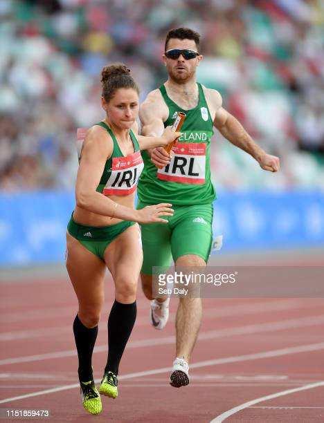 Minsk Belarus 25 June 2019 Sinead Denny of Ireland receives the baton from Andrew Mellon during the 4x400 Mixed Relay during Dynamic New Athletics...
