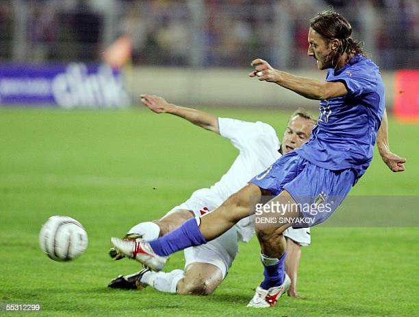 Italy's Francesco Totti fights for the ball with Belarus' Alexander Kulchy during their World Cup 2006 qualifying match in Minsk 07 September 2005...