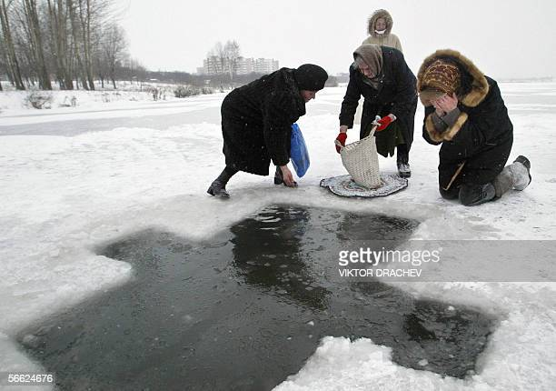 Orthodox believers collect Holly Water from a lake outside Minsk 19 January 2006 during the epiphany celebrations as the air temperature in dropped...
