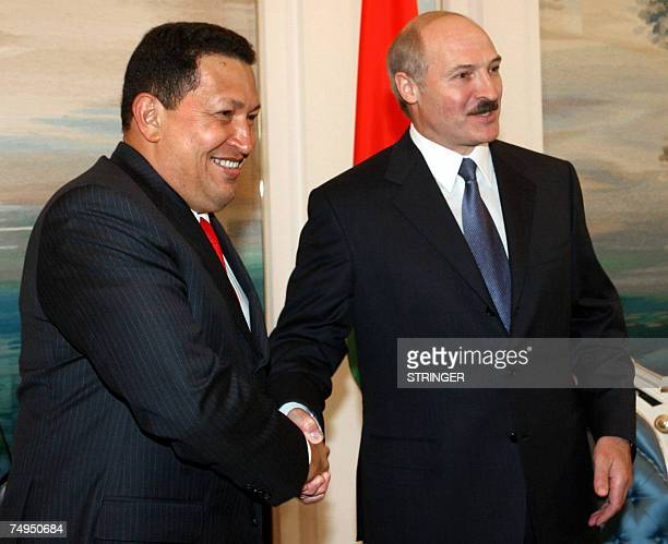 Venezuelan President Hugo Chavez and his Belarussian counterpart Alexander Lukashenko smile as they during a meeting in Minsk, 29 June 2007. Chavez...