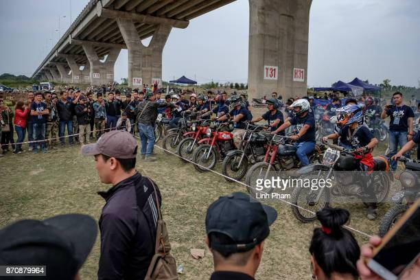 Minsk motorcyclists line up at the racing line on November 5 2017 in Hanoi Vietnam A new generation of Vietnamese have started to ply the roads...