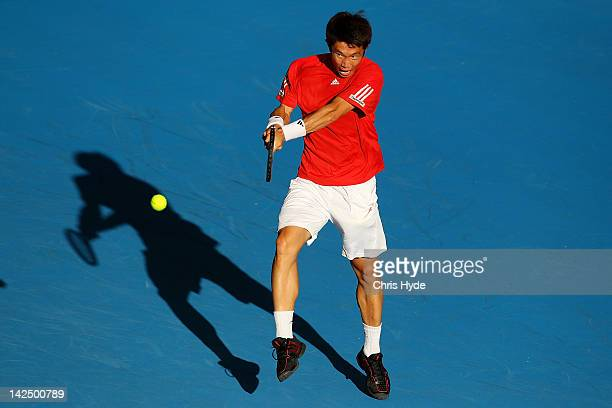 MinSukYoung Jeong of Korea plays a backhand in his singles match against Matthew Ebden of Australia on day one of the Davis Cup Asia Oceania Zone...