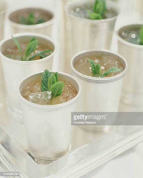 mint juleps in cups. - mint julep stock pictures, royalty-free photos & images
