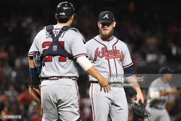 J Minter and Kurt Suzuki of the Atlanta Braves celebrate after defeating the Arizona Diamondbacks in the tenth inning of the MLB game at Chase Field...
